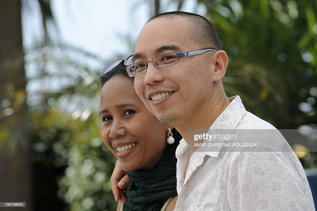 Thai actress Wallapa Mongkolprasert and Thai director Apichatpong Weerasethakul pose during the photocall 'Lung Boonmee Raluek Chat' (Uncle Boonmee Who Can Recall His Past Lives) presented in competition at the 63rd Cannes Film Festival on May 21, 2010 in Cannes.