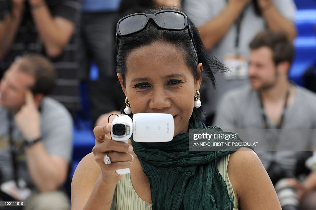 Thai actress Wallapa Mongkolprasert films as she poses during the photocall of 'Lung Boonmee Raluek Chat' (Uncle Boonmee Who Can Recall His Past Lives) presented in competition at the 63rd Cannes Film Festival on May 21, 2010 in Cannes.