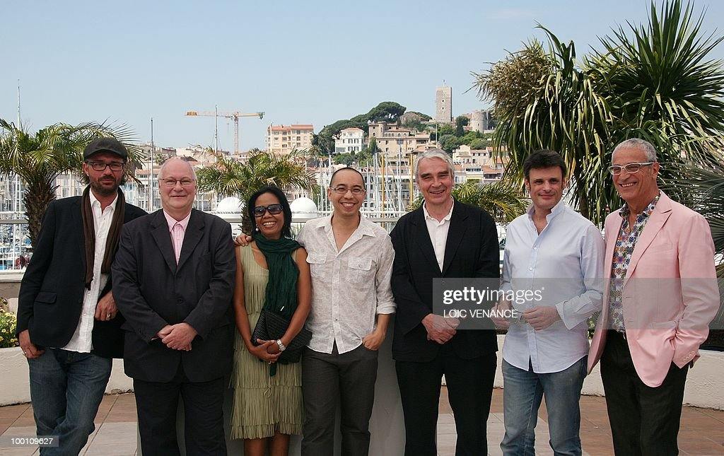 Thai actress Wallapa Mongkolprasert (3rdL), Thai director Apichatpong Weerasethakul (C), producer Simon Field (3eD), producer Keith Griffith, producer Charles de Meaux (2eD) and producer Luis Minarro (R) pose during the photocall 'Lung Boonmee Raluek Chat' (Uncle Boonmee Who Can Recall His Past Lives) presented in competition at the 63rd Cannes Film Festival on May 21, 2010 in Cannes.
