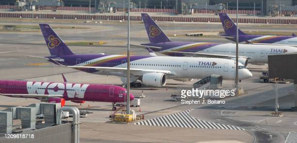 Thai air, planes at Suvarnabhumi Airport after the Bangkok government ordered most flights grounded due to the rapid spread if the Covid-19 virus or...
