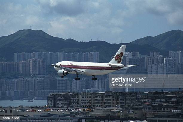 Thai Airways aircraft lands at Kai Tak airport in Kowloon Hong Kong