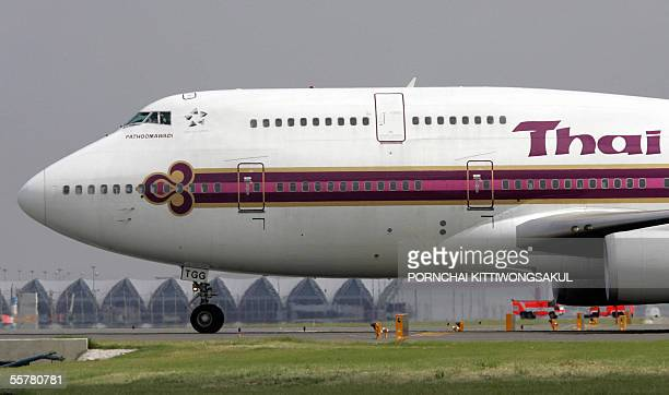 Thai airways aircraft taxis to a terminal during a recent system test at the Suvarnabhumi airport in Bangkok suburb 27 September 2005 The First...
