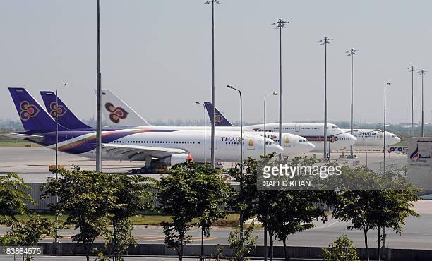 Thai airways planes are parked on the tarmac at the besieged Suvarnabhumi international airport in Bangkok on December 1 2008 Antigovernment...
