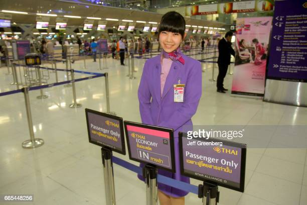 A Thai Airways representative at Suvarnabhumi International Airport