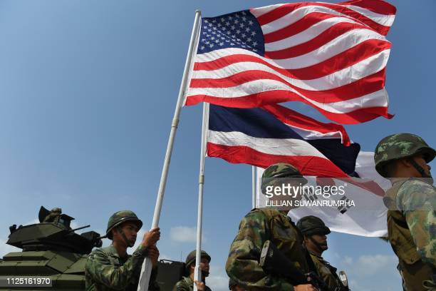 US Thai and South Korean flags are flown during an amphibious landing in Chonburi on February 16 at the multination Cobra Gold military exercises...