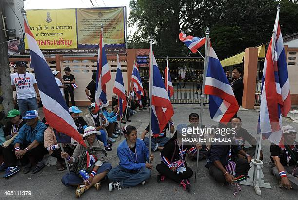 Thai antigovernment protesters gather outside a polling station in a bid to prevent people from voting in Narathiwat southern Thailand on January 26...
