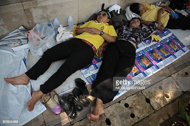 Thai anti-government protestors take a nap during a siege of the Government House in Bangkok on August 30, 2008. Defiant Thai protesters scuffled...