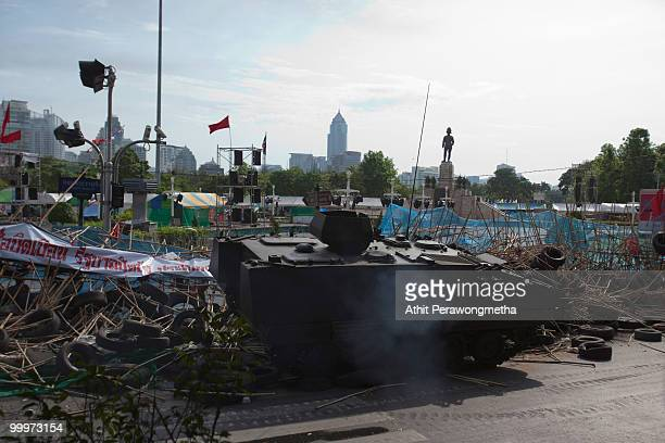 Thai armoured personnel carrier breaks down a barricade made by Antigovernment protesters 'Red Shirt' on May 19 2010 in Bangkok Thailand Protesters...