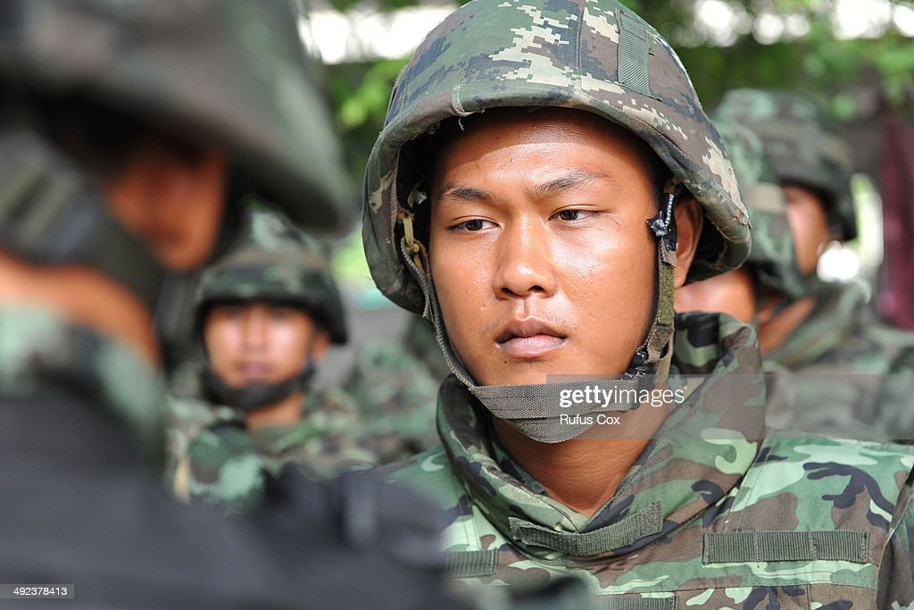 A Thai army officer briefs soldiers standing guard outside the National Broadcasting Services of Thailand after martial law was declared on May 20, 2014 in Bangkok, Thailand. The army imposed martial law across Thailand amid a deepening political crisis that has seen six months of protests and claimed at least 28 lives.
