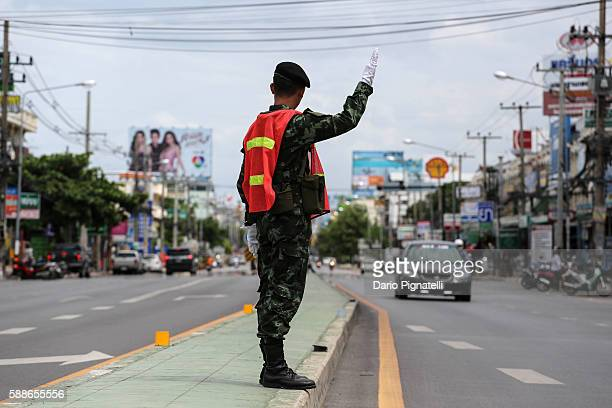 Thai Army officer controls cars traffic in Hua Hin Thailand on Friday August 12 2016 A series of coordinated blasts across Southern Thailand...