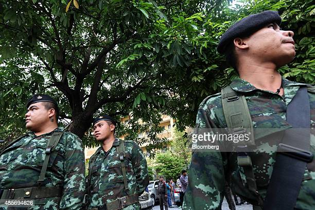 Thai Army officers stand outside a building where a suspect of the August 17 Bangkok shrine bombing was detained, in Nong Chok, North West of...