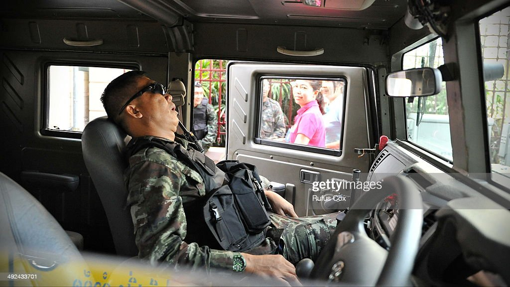 A Thai army soldier sleeps while deployed on a downtown street after martial law was declared on May 20, 2014 in Bangkok, Thailand. The army imposed martial law across Thailand amid a deepening political crisis that has seen six months of protests and claimed at least 28 lives.