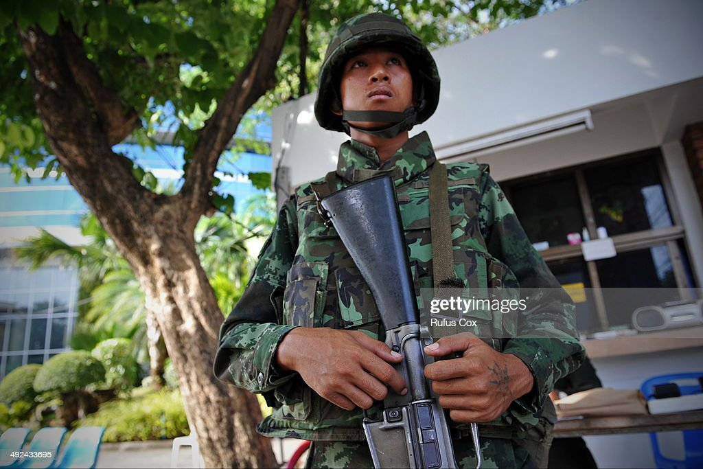 A Thai Army soldier stands guard outside the National Broadcasting Services of Thailand after martial law was declared on May 20, 2014 in Bangkok, Thailand. The army imposed martial law across Thailand amid a deepening political crisis that has seen six months of protests and claimed at least 28 lives.