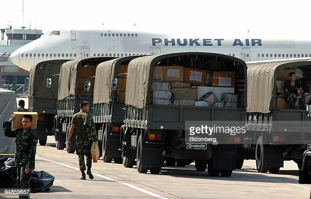 Thai army trucks loaded with relief supplies queue at Bangkok Thailand's military airport Wednesday December 29 2004 The death toll from the...