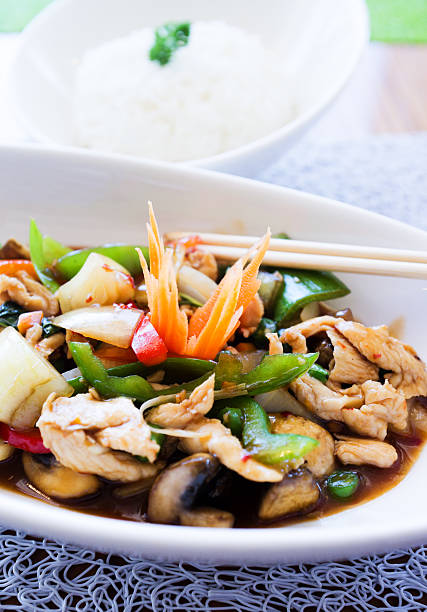 Thai basil chicken dish and bowl of jasmine rice