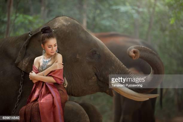 Thai beautiful girl with smiling elephant
