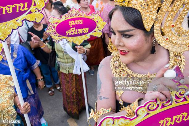 Thai beauty queens in traditional dress wait to walk in a wax candle procession during Buddhist Lent festivities Buddhist Lent known as Khao Phansa...