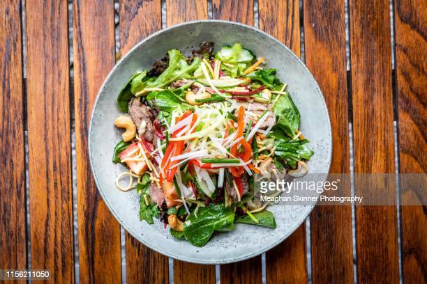 thai beef salad - salad stock pictures, royalty-free photos & images