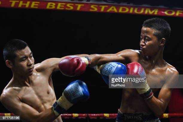Thai boxing combat between Aekapol vs Nong in 50kg category during Muaythai Monday Evening International Thai Boxing Gala in Thaphae Stadium in...