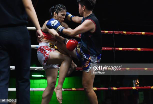 Thai boxing combat between Chabaphai vs Gwungthong in Ladies 58kg category during Muaythai Monday Evening International Thai Boxing Gala in Thaphae...