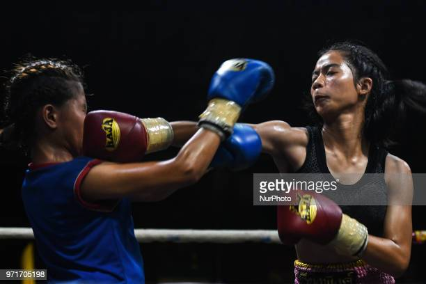 Thai boxing combat between Plerngwaree vs Nonggift in 46kg category during Muaythai Monday Evening International Thai Boxing Gala in Thaphae Stadium...