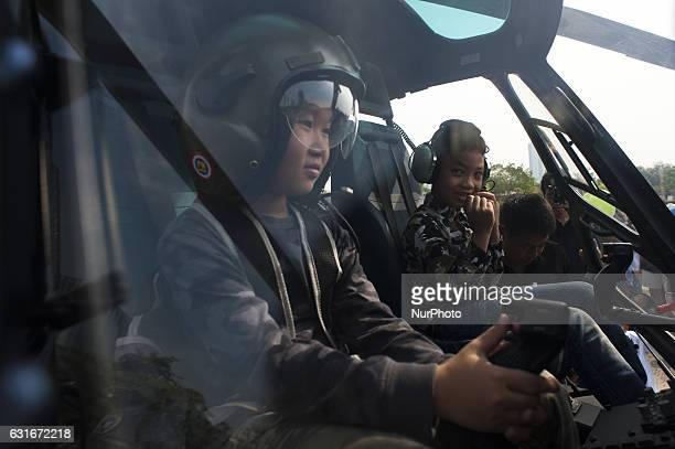 A Thai boy play a military helicopter during the National Children's Day event inside a military base in Bangkok Thailand on 14 January 2017