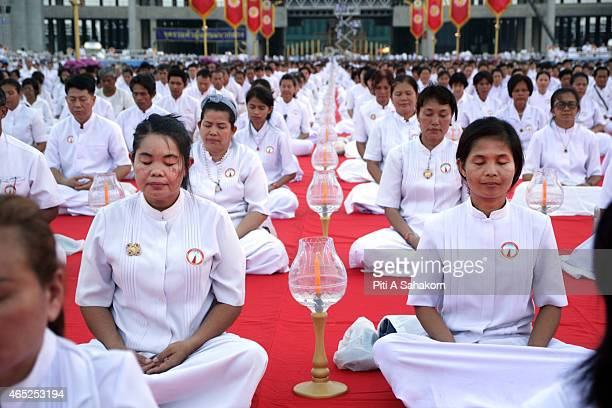 Thai Buddhist devotees meditate during a religious ceremony to mark Makha Bucha day at Dhammakaya Temple in Pathum Thani province. Makha Bucha day...