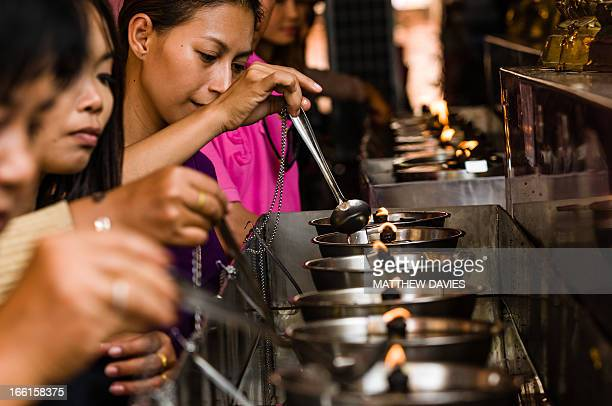 CONTENT] Thai Buddhist Lay People Keep Oil Lamps Burning For Merit In The Thai Temple Of Wat Yai In The Ancient Capital Of Ayutthaya Thailand
