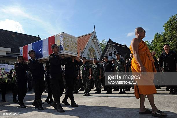 A Thai Buddhist monk leads the funeral ceremony of a Ranger who was killed the day before in a motorcycle bomb attack planted by suspected separatist...
