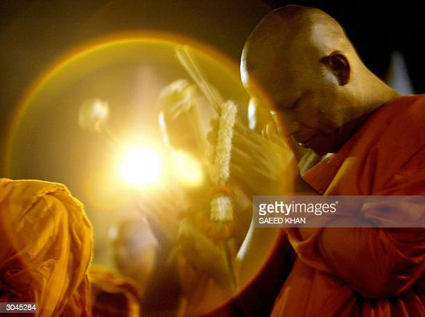 Thai Buddhist monk prays during a special worship to celebrate the Makha Pucha Day Buddhist festival at a famous Marble Temple in Bangkok 05 March...