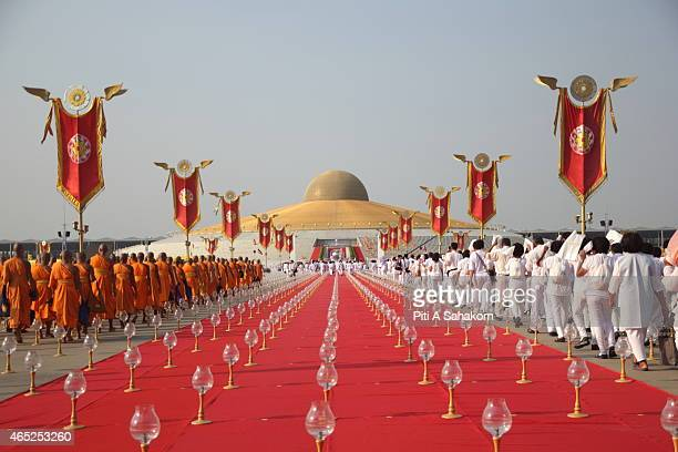 Thai Buddhist monks and Buddhist devotees take part in the candle lighting religious ceremony to mark Makha Bucha day at Dhammakaya Temple in Pathum...