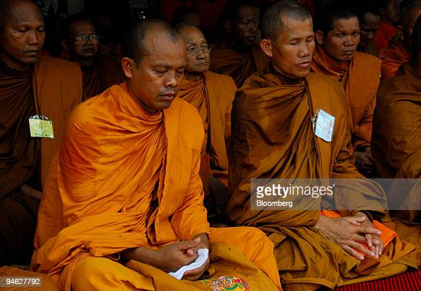 Thai Buddhist monks meditate and pray during a demonstration outside Parliament House in Bangkok Thailand on Wednesday April 25 2007 The...