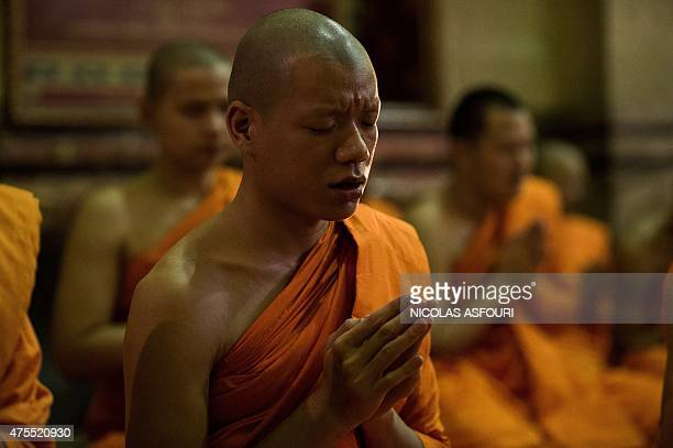 Thai Buddhist Monks perform religious rites during Visakha Bucha or Buddha Day celebration at Marble Temple in Bangkok on June 1 2015 Visakha Bucha...