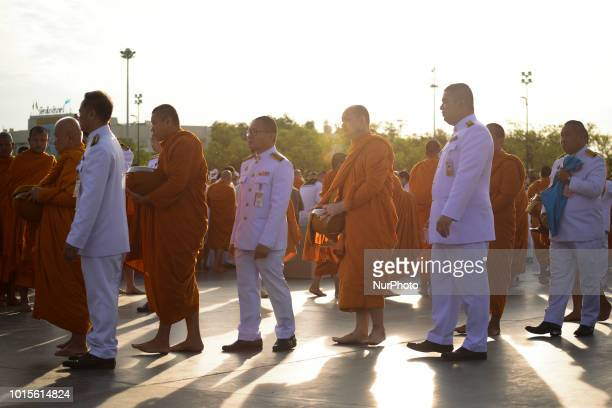 Thai Buddhist monks receive alms during as part of celebrate the Queens Sirikit' 86th birthday in Bangkok Thailand 12 August 2018