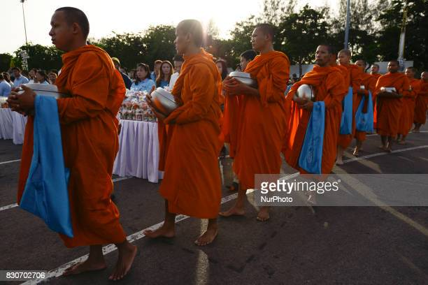 Thai Buddhist monks receive alms during as part of celebrate the Queens Sirikit' 85th birthday in Bangkok Thailand 12 August 2017