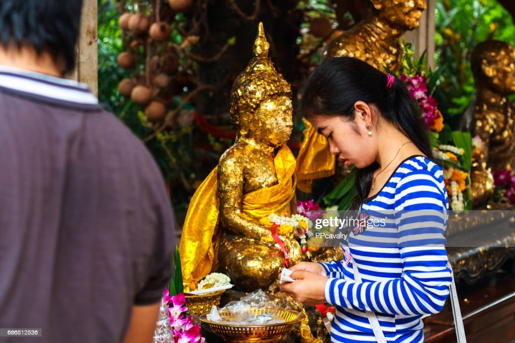 Thai Buddhist People Pray Buddha State With Water Lily Candle And
