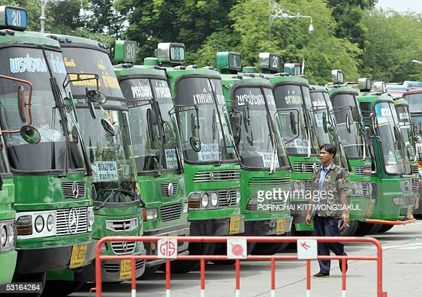 Thai bus driver walks in front of parked buses during a protest against the oil price crisis outside Parliament House in Bangkok 29 June 2005 Bus...