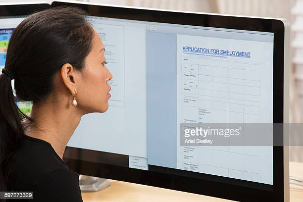 thai businesswoman working on computer - application form stock pictures, royalty-free photos & images