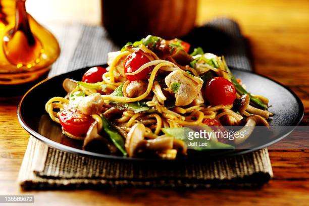 thai chicken stirfry with noodles - noodles stock pictures, royalty-free photos & images
