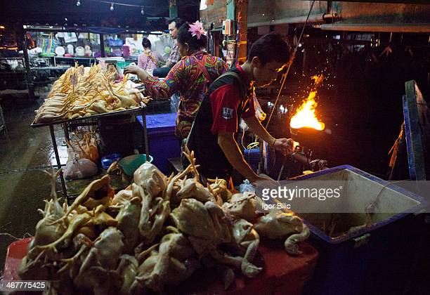 Thai chicken vendor sells fresh chicken at the Khlong Toey market in BangkokThailand Khlong Toey is a small and hidden neighborhood deep within the...