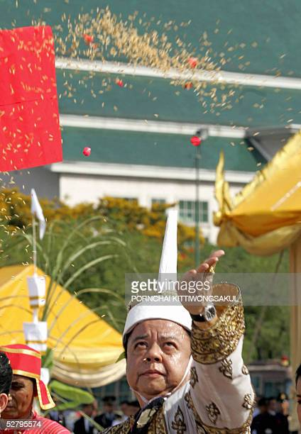Thai chief of ceremony throws rice seeds during the annual royal ploughing ceremony in Bangkok 11 May 2005 The Thai royal soothsayer predicted plenty...