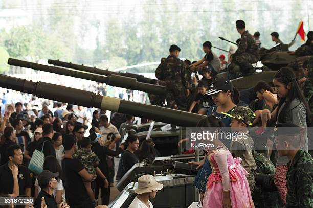 Thai children climb a military vehicle during the National Children's Day event inside a military base in Bangkok Thailand on 14 January 2017