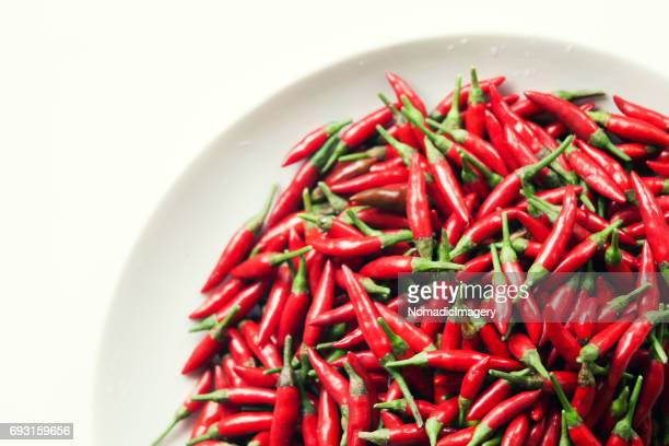 Thai Chili Peppers on plate with white background