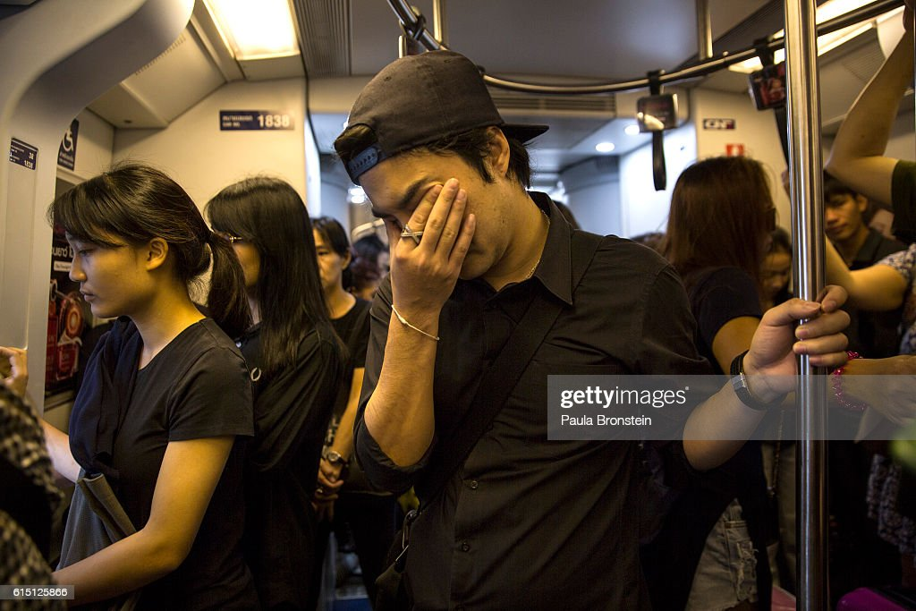 Thai commuters ride the Bangkok Sky Train honoring the late King by wearing black on October 17, 2016 in Bangkok, Thailand. Thailand's King Bhumibol Adulyadej, the world's longest-reigning monarch, died at the age of 88 in Bangkok's Siriraj Hospital on Thursday after his 70-year reign. The Crown Prince Maha Vajiralongkorn had asked for time to grieve the loss of his father before becoming the next king as nation waits for the coronation date.