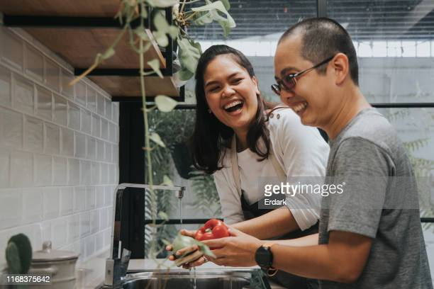 thai couple enjoy spending time for doing healthy food at home - couples showering stock pictures, royalty-free photos & images