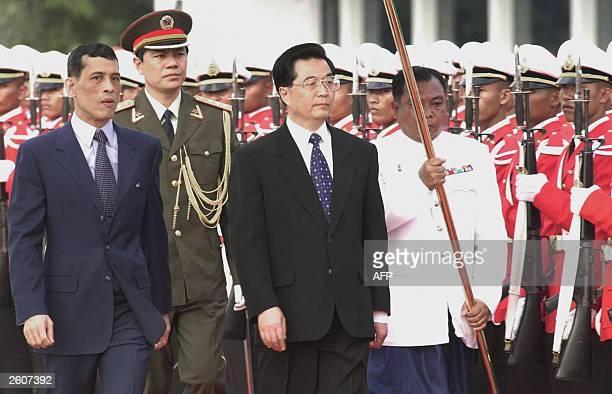 Thai Crown Prince Maha Vajiralongkorn leads visiting Chinese President Hu Jintao to review the honor guard at a military airport in Bangkok 17...