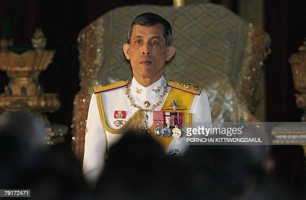 Thai Crown Prince Maha Vajiralongkorn reads statements during the opening session of the parliament at the parliament House in Bangkok 21 January...