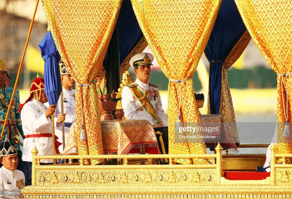 Thai Crown Prince Vajiralongkorn (C) sits on the Royal Barge on the Chao Phraya river during the Royal celebrations on November 5, 2007, in Bangkok, Thailand. Thailand's magestic royal barge procession, held to celebrate King Bhumibol Adulyadej's coming 80th birthday, swept along the Chao Phraya river without him. King Bhumipol, The world longest reigning monarch, has been in hospital since October 13 after suffering a blood clot in his brain.