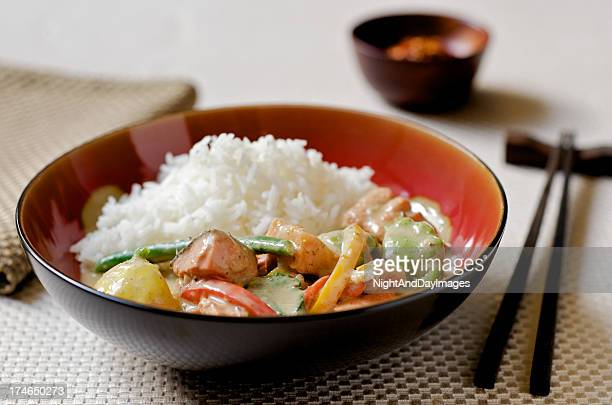 thai curry with fish, vegetables, and rice in asian setting - curry powder stock photos and pictures