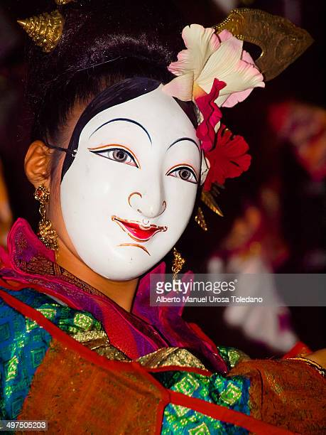 Thai dancer making a traditional performance dance in the King birthday celebration. The dancer wear a mask and Thai accessories. The image was taken...